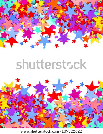 Colorful star shaped confetti on white background