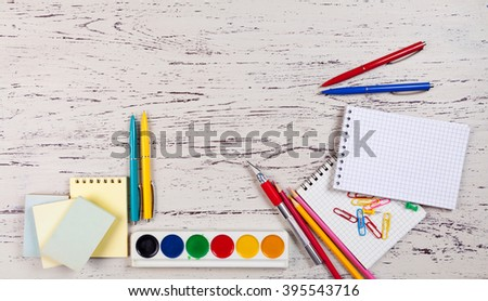 Colorful stationery on wooden table - stock photo
