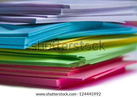 Colorful sticky notes are randomly stacked together