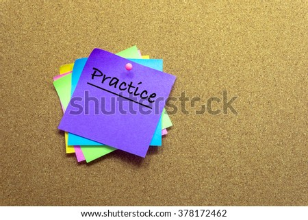 colorful sticky notes on cork bulletin board and write the words PRACTICE. - stock photo