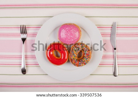 colorful stock image of doughnuts on white plate. diet concept - stock photo