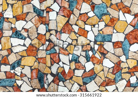 Colorful stone mosaic with chaotic pattern, seamless background photo texture - stock photo