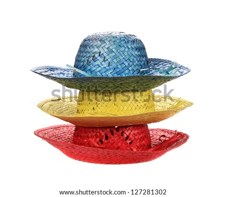 colorful straw hats on white background (cut out) - stock photo