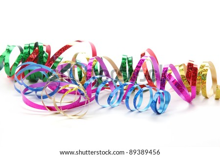 Colorful streamers on white background - stock photo