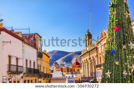 Colorful Street with Christmas Decorations and Tree San Roque Church Guanajuato, Mexico.  Mexican Government Building