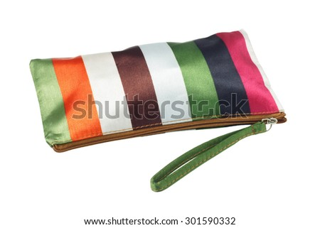 Colorful Striped Cosmetic Bag on White Background - stock photo