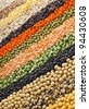colorful  striped rows of lentils, soya beans, peas, buckwheat, soybeans, legumes, rice, backdrop - stock photo