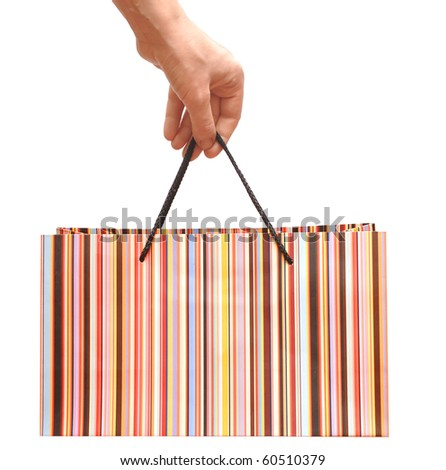 colorful striped shopping bag, on woman hand - stock photo