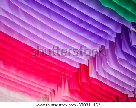 Colorful strips fabric in a row, background concept - stock photo