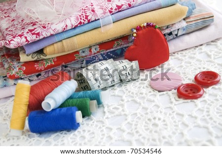 Colorful stuff for sewing at home, close up - stock photo
