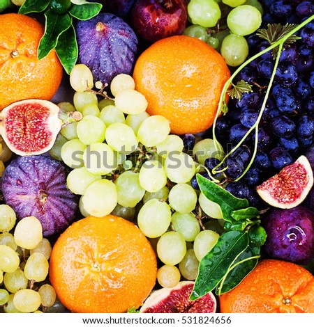 Colorful Summer Fruit Background with Grape, Figs and Tangerines. Diet, Healthy Eating and Fitness Concept