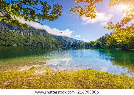Colorful summer morning on the Bohinj lake in Triglav national park Slovenia, Alps, Europe. - stock photo