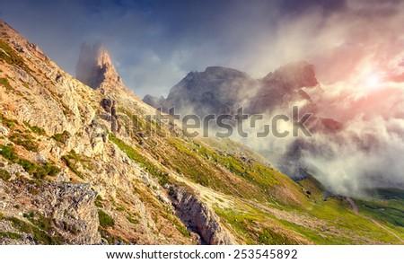 Colorful summer sunrise in the National Park Tre Cime di Lavaredo near rifugio Locatelli. Dolomites, South Tyrol. Location Auronzo, Italy, Europe. - stock photo