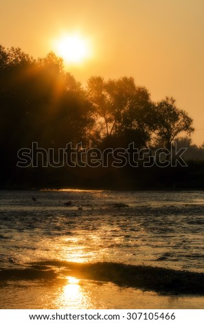 Colorful summer sunrise over the river Krka in Slovenia. - stock photo