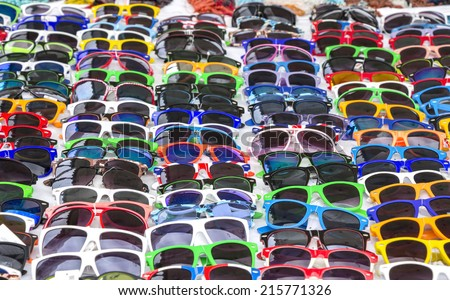 Colorful Sunglasses on sale at the city market  - stock photo