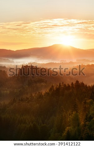 Colorful sunny autumn morning above the deep forest valley of national park Bohemian Switzerland in the Czech Republic - stock photo