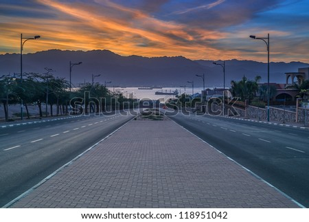 Colorful sunrise at Eilat - famous resort and recreation city of Israel - stock photo