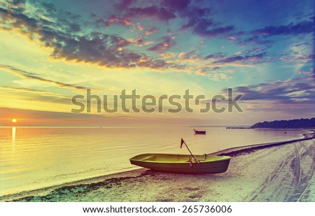 Colorful sunrise at village of fishermen with instagram effect for inspiration of retro style - stock photo