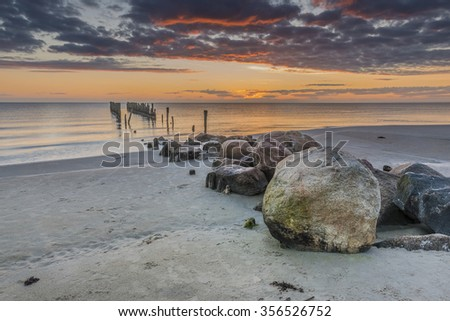 Colorful sunrise near a village of fishermen, Baltic Sea, Europe - stock photo