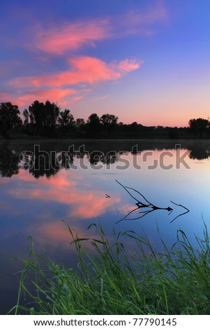 Colorful sunrise on the river - stock photo