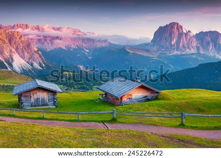 Colorful sunrise on the Sassolungo (Langkofel) and Sella group, valley Gardena. National Park Dolomites, South Tyrol. Location Ortisei, S. Cristina and Selva, Italy, Europe.  - stock photo