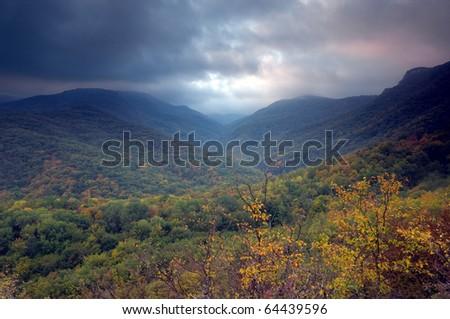 Colorful sunrise over mountains - stock photo