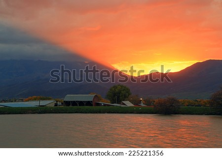 Colorful sunset above a small town in Heber Valley, Utah, USA. - stock photo
