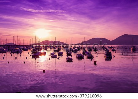 Colorful sunset above Mediterranean sea in Lerici, Italy.