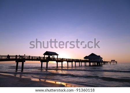 Colorful sunset at the beach. - stock photo