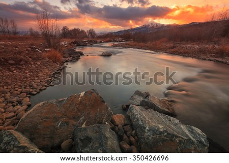 Colorful sunset at the Provo River, Utah, USA. - stock photo