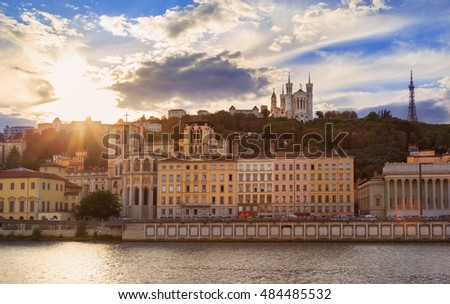 Colorful sunset at Vieux Lyon and Fourviere Basilica seen from the riverbank of the Saone, Lyon.