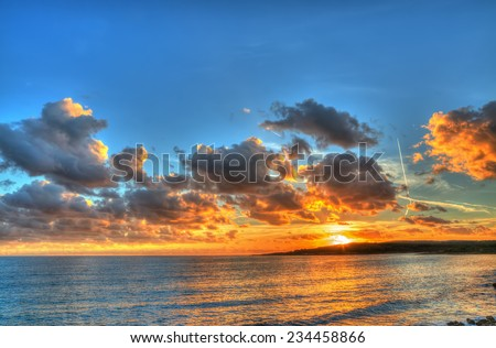 colorful sunset in Alghero coastline, Italy. Processed for hdr tone mapping effect. - stock photo