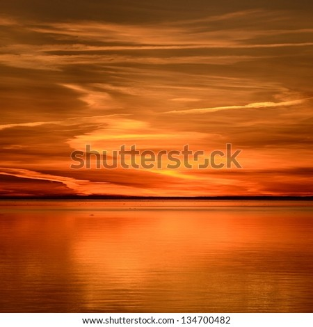 colorful sunset in the sea - stock photo
