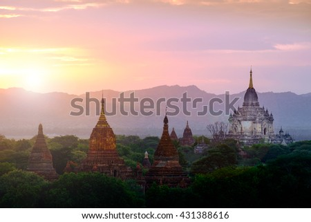 Colorful sunset landscape view with silhouettes of temples, Bagan, Myanmar (Burma) - stock photo