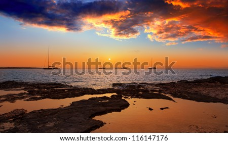 colorful sunset of Ibiza view from formentera with Es Vedra - stock photo
