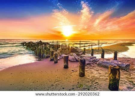 Colorful sunset on a beach. - stock photo