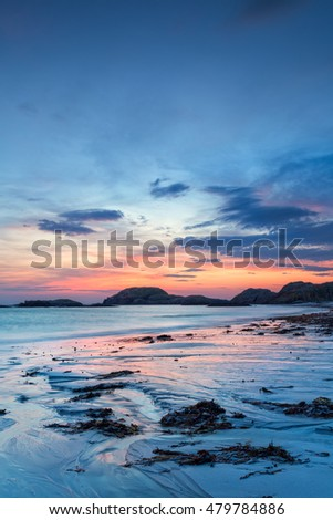 Colorful sunset on the beach of Iona, a small island of Inner Hebrides, Scotland