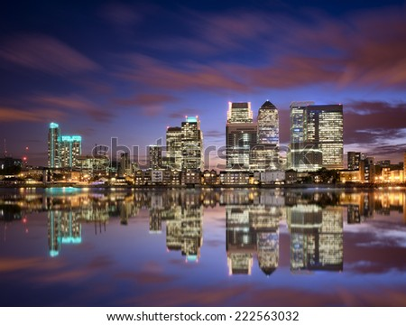 Colorful sunset over Canary Wharf, London skyline - stock photo
