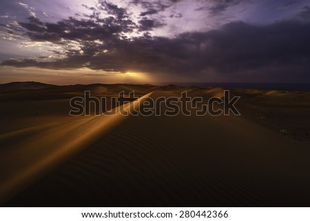 Colorful sunset over Chigaga desert, Morocco - stock photo
