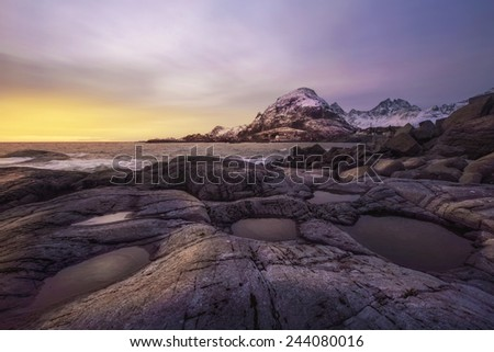 colorful sunset over Lofoten Islands, Norway in winter - stock photo