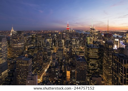 Colorful sunset over New York City, Manhattan - stock photo