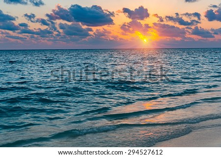 Colorful sunset over ocean on Maldives