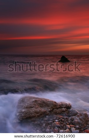 Colorful sunset over the ocean beach - stock photo