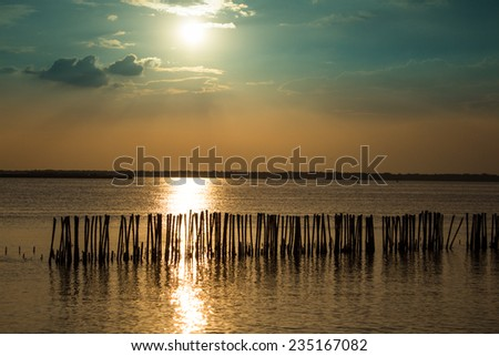 colorful sunset over water surface. - stock photo