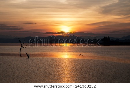 Colorful sunset over water surface - stock photo