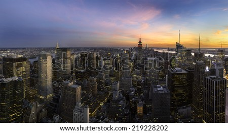 Colorful sunset panorama over Manhattan skyline, New York City - stock photo