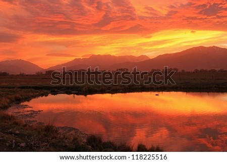 Colorful sunset reflection in the Utah mountains, USA. - stock photo