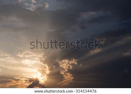colorful sunset sky background with clouds and sun light - stock photo