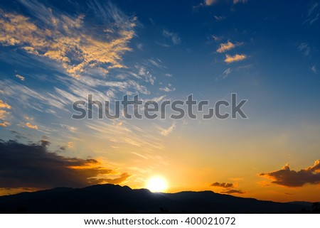 Colorful sunset sky over the mountain hills - stock photo