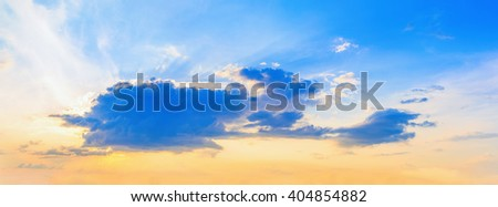 Colorful sunset sky with cumulus clouds. Beautiful bright sunset sky background. - stock photo